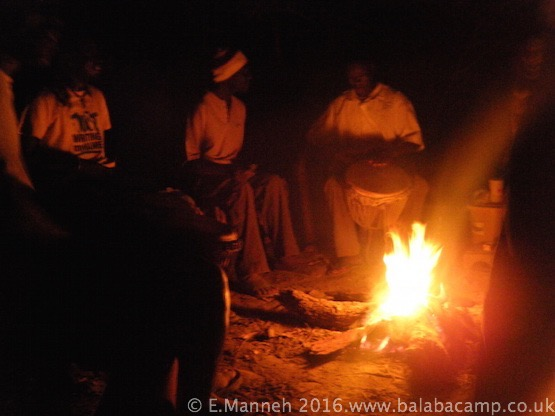 Drumming and dancing round the campfire
