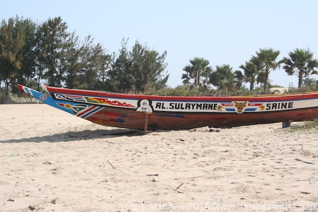A brightly painted pirogue on Gunjur Beach